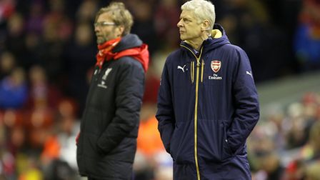 Arsenal manager Arsene Wenger (right) with Liverpool manager Jurgen Klopp on the touchline.