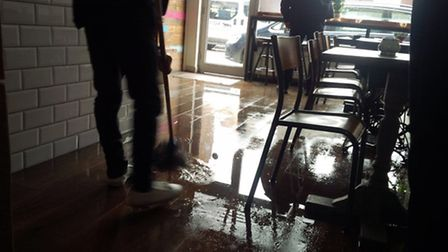 Mopping up after the flood. Picture: Highness Cafe