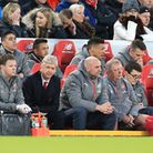 Arsenal manager Arsene Wenger (second left) in the dugout during the Premier League match at Anfield