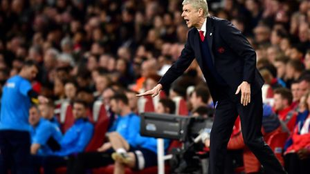 Arsenal manager Arsene Wenger gestures on the touchline during the Emirates FA Cup quarter final at
