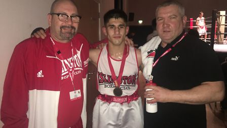 Islington's Boxing Club's Masood Abdullah with coaches Roy Callaghan (right) and Kevin Daly (left).
