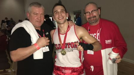 Islington's Boxing Club's Slavisa Gegic with coaches Roy Callaghan (left) and Kevin Daly (right). Pi