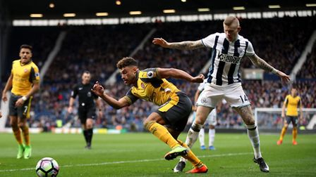 Arsenal's Alex Oxlade-Chamberlain and West Bromwich Albion's James McClean compete for the ball duri