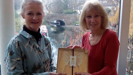Sasha Mears, left, is presented with a pair of chocolate 'Angel' wings by Beryl Windsor. Picture: To