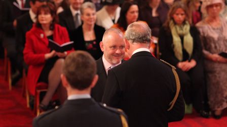 Terry Stacy receives his MBE from Prince Charles in 2012. Picture: Anthony Devlin/PA Wire