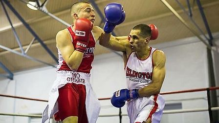Islington Boxing Club's Darren Ballinger (white) and team mate Mo Gharib (red) battle it out in the