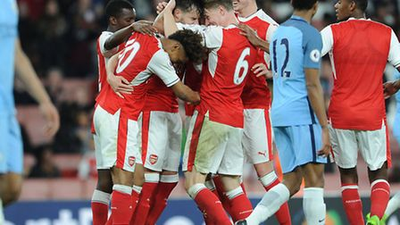 Carl Jenkinson celebrates scoring Arsenal's 3rd goal with Ben Sheaf and Reiss Nelson during match be