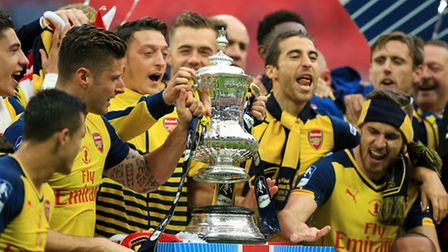 Arsenal players celebrate with the FA Cup trophy