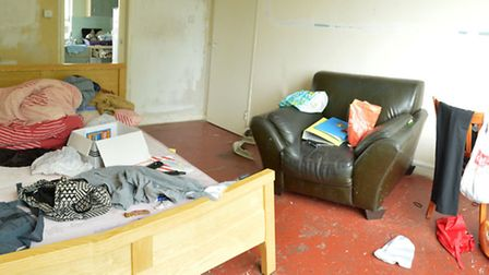 The messy living room where Demi Williams' body was found
