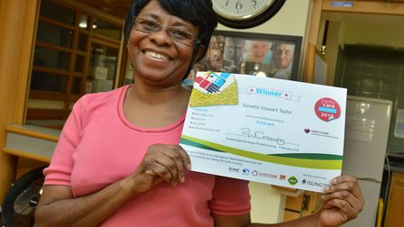 Toinette Taylor with her Dignity in Care award certificate