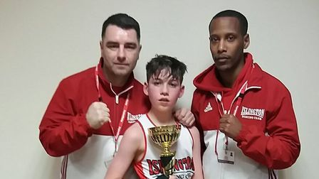 Islington Boxing Club's Patrick McDonagh with coaches Zowie Campbell and Scott Smart. Picture: REGGI