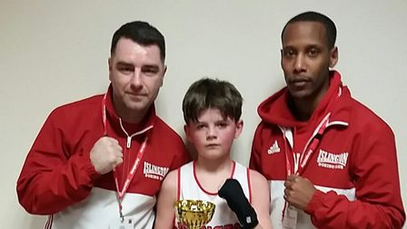 Islington Boxing Club's Liam Byrne with coaches Zowie Campbell and Scott Smart. Picture: REGGIE HAGL