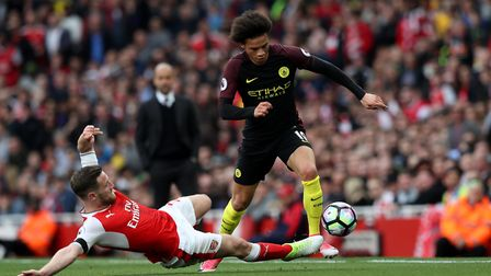 Manchester City's Leroy Sane (right) is tackled by Arsenal's Shkodran Mustafi