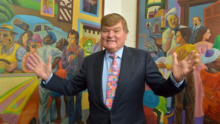 Whittington Health chairman Steve Hitchins with two Ray Walker pieces at the Whittington Hospital.
