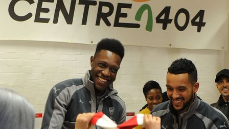 Arsenal's Danny Welbeck and Theo Walcott on a visit to Centre 404 in December. Picture: Stuart MacFa
