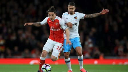 Arsenal's Hector Bellerin (left) and West Ham United's Manuel Lanzini battle for the ball during the