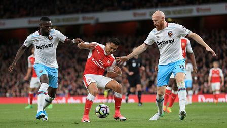 West Ham United's Arthur Masuaku and James Collins try to close down Arsenal's Alexis Sanchez (pic N