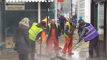 It's all hands on deck in Camden Passage to get the businesses back up and running