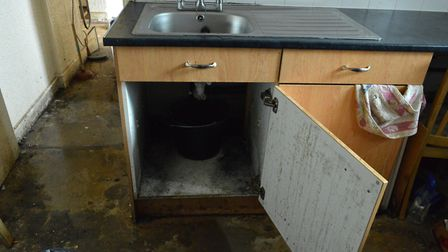 Mouldy sink unit in Kike Ogunseye's flat at Colley House Hilldrop Estate. Picture: Polly Hancock