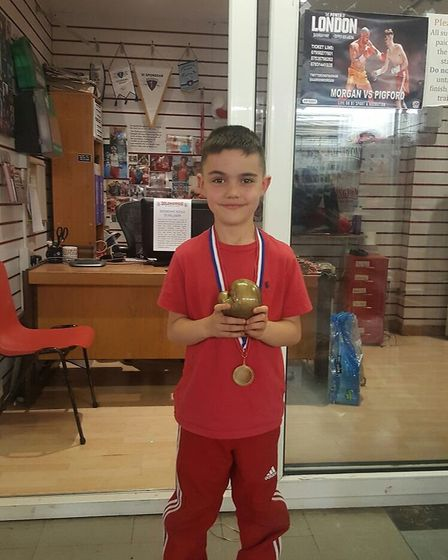 Dillon Schiavo with his most improved boxer award from Islington Boxing Club's infant classes Thursd