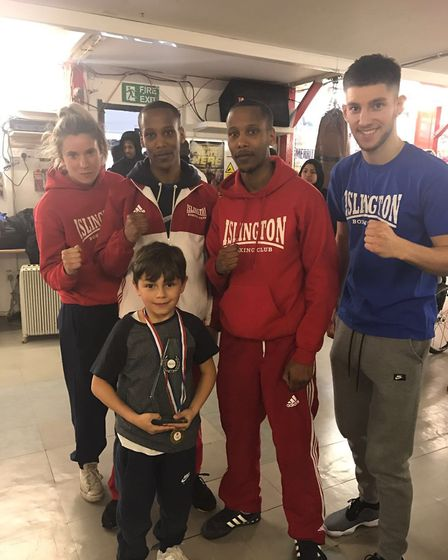 Leon Flanagan, seen with his coaches, picked up the best boxer of the term award from Islington Boxi