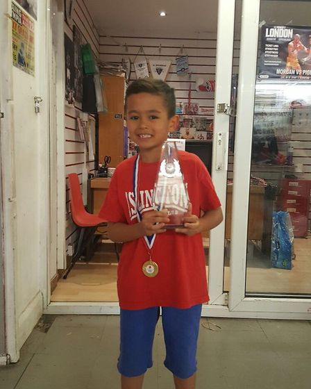 Julius Tait with his best boxer of the term award from Islington Boxing Club's infant classes Thursd