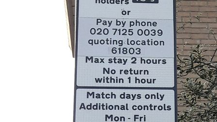 """The council workers forgot to cover up the """"am"""" on the additional parking controls."""