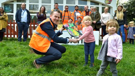 Eoin Regan, project manager for Hochtief, is given a 'thank you' card by children at Highbury Fields