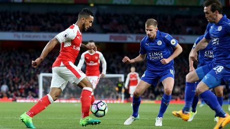 Arsenal's Theo Walcott attempts a shot during the Premier League match at the Emirates Stadium, Lond