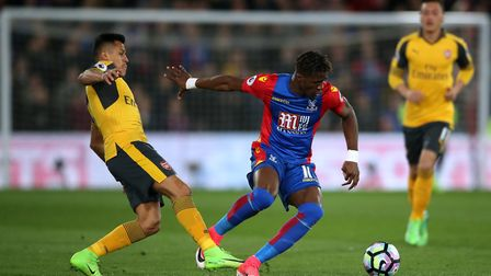 Arsenal's Alexis Sanchez (left) and Crystal Palace's Wilfried Zaha battle for the ball (pic Nick Pot