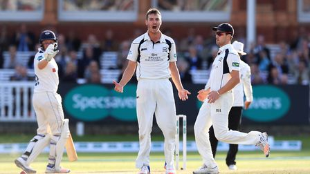 Middlesex's Toby Roland-Jones celebrates taking the wicket of Yorkshire's Tim Bresnan during day fou