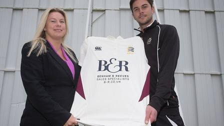 A representative from sponsor Benham & Reeves with North Middlesex captain Tom Nicoll (pic George Ph
