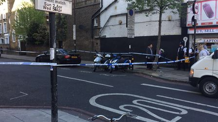 Sussex Way is taped off by police. Picture: Kris Milovsorov