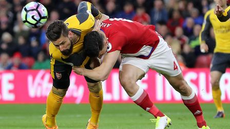 Arsenal's Olivier Giroud (left) and Middlesbrough's Daniel Ayala battle for the ball during the Prem