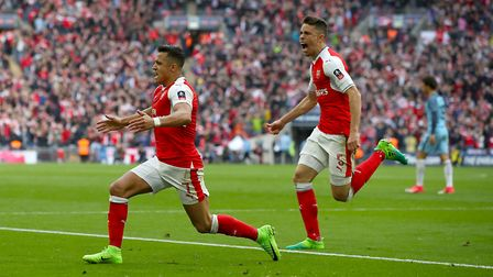 Arsenal's Alexis Sanchez celebrates scoring his side's second goal of the game during the Emirates F