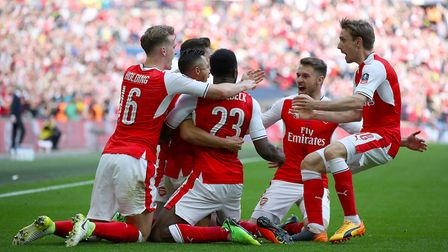 Arsenal's Alexis Sanchez celebrates scoring his side's second goal of the game with team mates durin