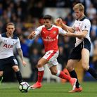 Arsenal's Alexis Sanchez and Tottenham Hotspur's Eric Dier battle for the ball at White Hart Lane (p