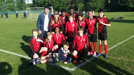 Central Foundation's year seven pupils celebrate their 8-0 win over Haverstock in the Islington & Ca
