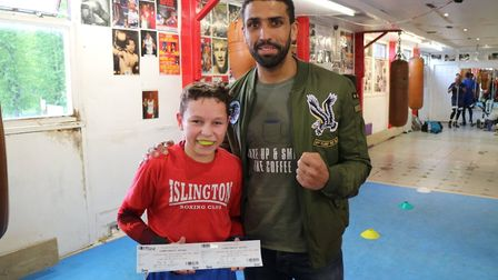 Aarron Morgan hands over free tickets for his next fight to Islington BC youngster Harry Betteridge