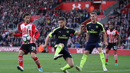 Arsenal's Rob Holding looks on (right) as team-mate Shkodran Mustafi clears the ball at Southampton