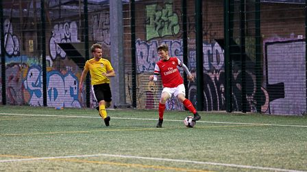 An Islington Admiral United player shows some skill in the Invitation Cup final against Islington 49