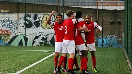 Islington Admiral United players celebrate a goal in the Invitation Cup final against Islington 49er