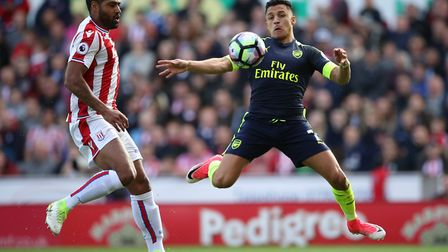 Arsenal's Alexis Sanchez (right) and Stoke City's Glen Johnson battle for the ball (pic Nick Potts/P