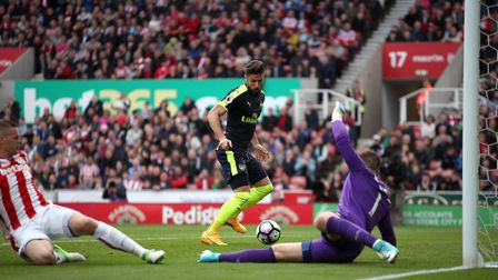 Arsenal's Olivier Giroud (centre) scores his side's first goal against Stoke (pic Nick Potts/PA)