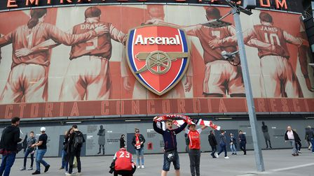 Arsenal fans pose for a picture before a Premier League match at the Emirates Stadium (pic John Walt