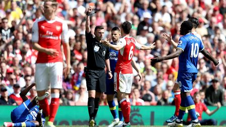 Arsenal's Laurent Koscielny (centre right) is sent-off by match referee Michael Oliver (centre left)