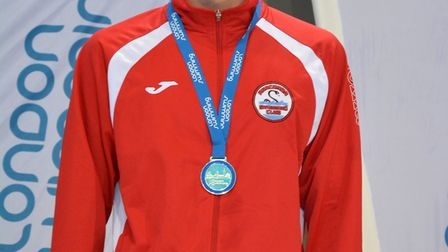 Anaconda Swimming Club's Tommy Donovan with his gold medal at the London Youth Championships (pic An