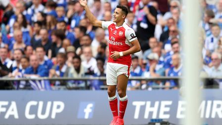 Arsenal's Alexis Sanchez celebrates scoring his side's first goal of the game during the Emirates FA