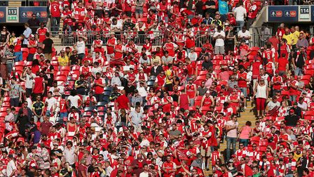 Arsenal fans in the stands during the Emirates FA Cup Final at Wembley Stadium, London.