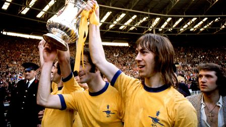 (L-R) Arsenal's Frank McLintock, George Graham and Charlie George celebrate with the FA Cup after th
